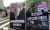 A photo showing U.S. President Donald Trump and North Korean leader Kim Jong Un is displayed to oppose military exercises between the United States and South Korea