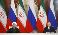 Russian President Vladimir Putin, right, and Iranian President Hassan Rouhani attend a joint news conference