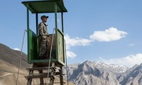 A Tajik conscript looks out over remote stretches of northern Afghanistan from a border outpost near Khorog, Tajikistan.