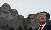 Donald Trump smiles at Mount Rushmore National Memorial