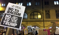 Demonstrators hold banners during a protest against U.S. President Donald Trump's controversial travel ban on refugees and people from 7 mainly-Muslim countries, in Oxford, England