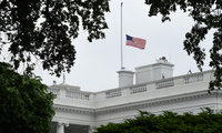 The American flag is lowered to half-staff at the White House