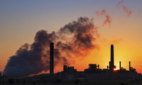 Dave Johnson coal-fired power plant is silhouetted against the morning sun